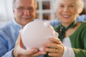 Elderly woman saving for retirement